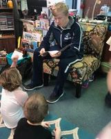 Varsity Basketball Team Takes Time to Read to Ling Elementary Students
