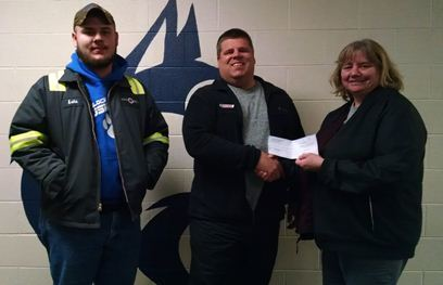 Corrigan Oil makes Donation to Hemlock Sports Boosters